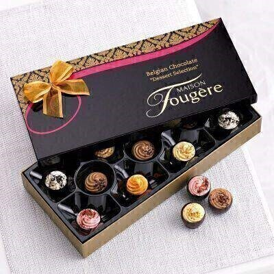 THIS ITEM WILL NEED TO ACCOMPANY A FLOWER ORDER OR BE A COMBINATION OF EXTRA ITEMS TO REACH OUR MINIMUM ORDER OF 25<br><br>These Dessert Selection chocolates in a stylish black and gold box are a lovely added treat. This box contains 11 Belgian Dessert Selection chocolates (180g).<br><br>This products does not contain any artificial colours or flavours. Contains: Milk Lactose Nuts Soya. May contain traces of Egg Gluten other Tree Nuts Peanuts.<br><br>This products is alcohol free. This product is not suitable for vegetarians.