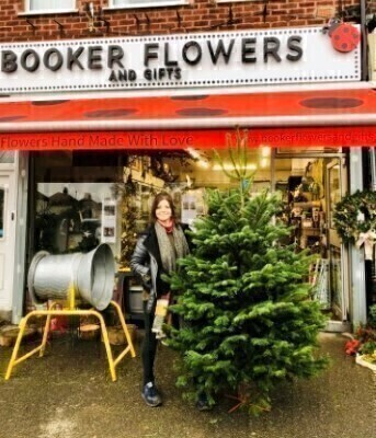 At Booker Flowers and Gifts only sell Grade A1 Quality Noordman Pine Christmas Trees.  We are well known for being one of the best suppliers of Xmas Trees in Allerton Liverpool L18. Our Trees are available to select and we can also deliver your Christmas Tree to you.<br><br> This is for a 6-7ft Xmas tree if you don't have one we would recommend that you buy a metal stand to put this into.<br><br> THIS CHRISTMAS TREE IS ONLY AVAILABLE FOR DELIVERY TO AREAS WE CAN DELIVER TO LOCALLY.<br><br> Grade A1 Quality in Christmas Trees means we get the pick of the best shapes and our Noordman pine Christmas Trees are the low needle drop variety from Scandinavia.<br><br> At Booker Flowers and Gifts Allerton Liverpool L18 we have been selling Christmas Trees for over 30 years so really know our stuff. We have used the same supply chain for this whole time so our trees come from a trusted source and over the years we have become known for selling the Best Christmas Trees. With many people coming to us year after year.<br><br> You can have your Christmas Tree Delivered to you however this service is only available for areas we delivery to Locally so Liverpool L1 L2 L3 L8 L15 L16 L17 L18 L19 L24 L25 L26 Call us if you would like to have a tree delivered but are outside of these areas.<br><br> For best longevity freshly cut the stem and leave in a bucket of water for 24hrs before bringing indoors or alternatively if raining just leave your Christmas tree in the garden for it to bring water in through the needles.  Place your tree place away from direct heat and spray every few days.<br><br> IF YOU HAVE A PREFERENCE OF WIDTH OF YOUR XMAS TREE LET US KNOW IN THE MESSAGE BOX IF YOU WOULD LIKE A FAT  THIN OR AVERAGE WIDTH. <br><br> If you would like Xmas Trees Delivered in Allerton Liverpool L18 think Booker Flowers and Gifts. Or come and our store to select our perfect low drop needle Christmas Tree from our large stock of beautiful Noordman Pines