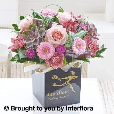 Pink Flowers Box of Flowers<br><br>Liverpool Flower Delivery<br><br>We offer advanced booking flower delivery same day flower delivery 3 hour Flower delivery guaranteed AM PM or Evening Flower Delivery and we are now offering Sunday Flower Delivery. .<br><br>Hand arranged by our florists To give the best occasionally we may make substitutes Our flowers backed by our 7 days freshness guarantee Approximate dimensions 45x45cm This product is available for delivery throughout the UK<br><br>THIS PRODUCT COMES HAND ARRANANGED AND GIFT WRAPPED IN A WATER BUBBLE PRESENTED IN A BOX This sumptuous hand-tied evokes an era of vintage glamour. Distinctive cymbidium orchids in a gorgeous shade of dark blush marry with pale pink roses and an ultra-fashionable succulent to create a timeless design.<br><br>Featuring 5 pink cymbidium orchid heads 3 pink germini 3 pale pink large headed roses and 2 echeveria with aralia leaves Aspidistra leaf cordyline flexigrass salal and China grass wrapped and trimmed with gold organza ribbon.<br><br>The best florist in Liverpool<b><b>Come to Booker Flowers and Gifts Liverpool for your Beautiful Flowers and Plants if you really want to spoil we also have a great range of Wines Champagne Balloons Vases and Chocolates that can be delivered with your flowers. To see the full range see our extras section. You can trust Booker Flowers and Gifts can deliver the very best for you