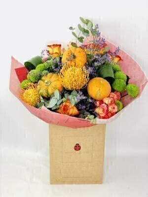 Autumn Flowers and Mini Pumpkin Handtied: Booker Flowers and Gifts