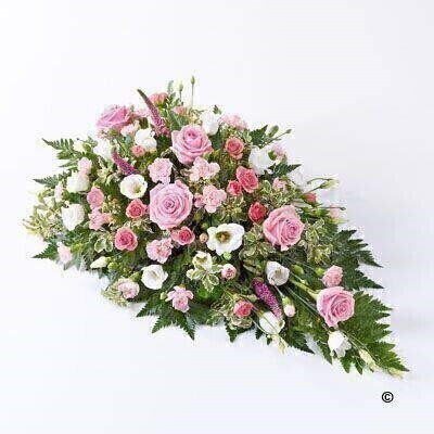 A beautiful tribute for a baby girl - this pretty pink spray features large-headed roses - spray carnations and spray roses in soft pink - interspersed with dark pink Veronica and delicate white lisianthus. It is finished with leather leaf and pittosporum.