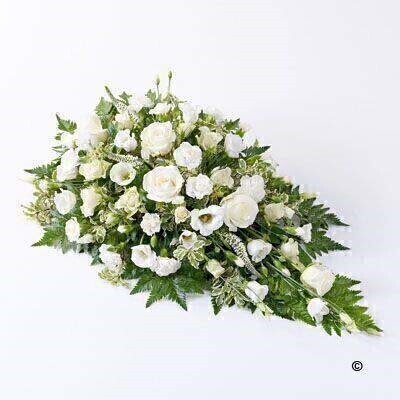 White large-headed roses - lisianthus - spray carnations - spray roses and Veronica are carefully arranged with leather leaf and pittosporum to create this delicate spray.
