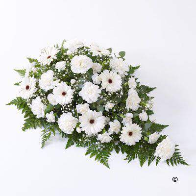 Fresh carnations - spray carnations - germini and gypsophilia - all in pristine white - are beautifully arranged in a teardrop shaped spray. We've added dark green leather leaf and fragrant eucalyptus to finish this graceful tribute.