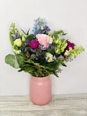 Mixed Flowers in a Pink Ceramic Jar