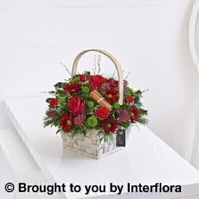 <h1>Flowers Delivered Liverpool</h1><br><br> This pretty flower basket in radiant red and gold makes a very charming Christmas gift that brings a burst of colour to enhance any home. Beautifully arranged and ready to display straight away  they are sure to be overjoyed with your thoughtfulness.<br><br>  Featuring 2 red carnations  3 red spray carnations  a red spray chrysanthemum  a red large headed rose with gold glitter and a white wax flower with silver glitter  blue spruce  holly and a glittered gold pine cone  presented in a soft brown basket.<<br><br> We offer advanced booking flower delivery same day flower delivery 3 hour Flower delivery guaranteed AM PM or Evening Flower Delivery and we are now offering Sunday Flower Delivery.<br><br><ul><li>Hand arranged in floral foam by our florists into a woven basket</li><li> To give the best occasionally we may make substitutes </li><li>Our flowers backed by our 7 days freshness guarantee</li><li> Approximate dimensions 33x38cm </li><li>This product is available for delivery throughout the UK </li></ul><br><br>The best florist in Liverpool<br><br>  Come to Booker Flowers and Gifts Liverpool for your Beautiful Flowers and Plants if you really want to spoil we also have a great range of Wines Champagne Balloons Vases and Chocolates that can be delivered with your flowers. To see the full range see our extras section. You can trust Booker Flowers and Gifts can deliver the very best for you