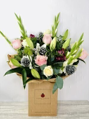 Christmas Seasonal Glamour Hand Tied Extra Large: Booker Flowers and Gifts