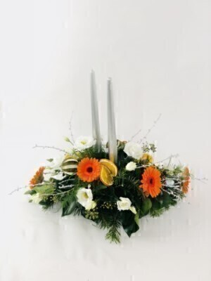 Christmas Table Centrepiece with Silver Candles: Booker Flowers and Gifts