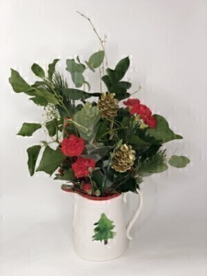 <h1>Flowers Delivered Liverpool</h1><br><br>Featuring double white freesia  red hypericum sprays  white roses with silver glitter  green spray chrysanthemums  eucalyptus  holly  salal tips  burgundy skimmia spray and blue spruce  arranged in a Christmas tree ceramic jug.<br><br> We offer advanced booking flower delivery same day flower delivery 3 hour Flower delivery guaranteed AM PM or Evening Flower Delivery and we are now offering Sunday Flower Delivery.<br><br><ul><li>This product is hand arranged and comes in the container<li><li> To give the best occasionally we may make substitutes </li><li>Our flowers backed by our 7 days freshness guarantee</li><li> Approximate dimensions 34x28cm </li><li>This product is available for delivery throughout the UK </li></ul><br><br>The best florist in Liverpool<br><br>  Come to Booker Flowers and Gifts Liverpool for your Beautiful Flowers and Plants if you really want to spoil we also have a great range of Wines Champagne Balloons Vases and Chocolates that can be delivered with your flowers. To see the full range see our extras section. You can trust Booker Flowers and Gifts can deliver the very best for you