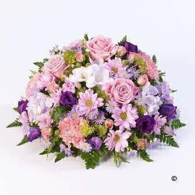 A classic selection in lilac and pink including large-headed roses - freesias - lisianthus and spray chrysanthemums presented in a large posy design.