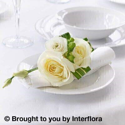White Flowers  Table Decoration<br><br>Liverpool Flower Delivery<br><br>We offer advanced booking flower delivery same day flower delivery 3 hour Flower delivery guaranteed AM PM or Evening Flower Delivery and we are now offering Sunday Flower Delivery. .<br><br>Hand arranged by our florists To give the best occasionally we may make substitutes As this is a wired product longevity of flowers can not be guaranteed Approximate dimensions 13x11cm This product is available for delivery throughout the UK<br><br>THIS PRODUCT IS A TEMPORARY TABLE DECORATION ONCE MADE THE FLOWERS ARE NOT DRINKING SO LONGEVITY OF FLOWERS BEYOND THE WEDDING OR EVENT CAN NOT BE GUARANTEED.  WE RECOMMEND DELIVERY TO BE AROUND 2 HOURS BEFORE THE EVENT SO PLEASE STATE TIME OF THE EVENT IN THE SPECIAL DELIVERY INSTRUCTIONS For a perfect balance of elegance and simplicity these flower napkin decorations are ideal. Two pristine white roses are hand-tied with lisianthus and greenery to create a stylish and luxurious treat for your guests as they take their seats at the table.<br><br>Featuring a green hypericum a white lisianthus and 2 white large headed roses with variegated dracaena trimmed with natural raffia.<br><br>The best florist in Liverpool<b><b>Come to Booker Flowers and Gifts Liverpool for your Beautiful Flowers and Plants if you really want to spoil we also have a great range of Wines Champagne Balloons Vases and Chocolates that can be delivered with your flowers. To see the full range see our extras section. You can trust Booker Flowers and Gifts can deliver the very best for you