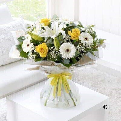 Send your congratulations in style with this bright and sunny bouquet. Weandrsquo;ve carefully hand-tied a selection of white lilies and germini and added radiant yellow roses for a perfect contrast. Tiny white gypsophila flowers give this gift an extra touch of magic. Featuring white germini - yellow large-headed roses - white Oriental lilies and white gypsophila - hand-tied with folded aspidistra leaves - eucalyptus and salal - wrapped and trimmed with yellow andlsquo;Congratulationsandrsquo; ribbon.