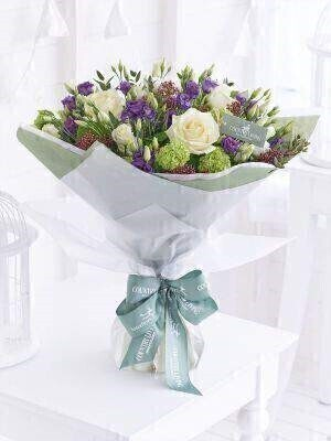 <h1>Flowers Delivered Liverpool</h1><br><br> This stylish bouquet is a modern take on a wintery colour palette that looks simply spectacular. The classic cream roses are partnered forest green  warm burgundy  and rich purple – effectively showcasing some of the more unusual seasonal shades beautifully.<br><br> Featuring 3 white large headed roses  3 purple lisianthus  3 white lisianthus  3 burgundy skimmia and 3 green viburnums with eucalyptus and salal  wrapped and trimmed with a Country Living satin ribbon  tag and gift card<br><br> We offer advanced booking flower delivery same day flower delivery 3 hour Flower delivery guaranteed AM PM or Evening Flower Delivery and we are now offering Sunday Flower Delivery.<br><br><ul><li>This product is hand arranged and comes in a water bubble<li><li> To give the best occasionally we may make substitutes </li><li>Our flowers backed by our 7 days freshness guarantee</li><li> Approximate dimensions 54x46cm </li><li>This product is available for delivery throughout the UK </li></ul><br><br>The best florist in Liverpool<br><br>  Come to Booker Flowers and Gifts Liverpool for your Beautiful Flowers and Plants if you really want to spoil we also have a great range of Wines Champagne Balloons Vases and Chocolates that can be delivered with your flowers. To see the full range see our extras section. You can trust Booker Flowers and Gifts can deliver the very best for you