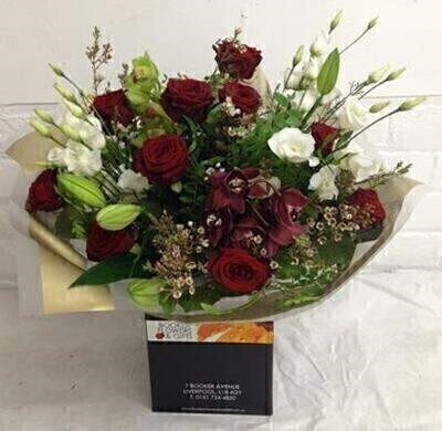 Cymbidium Orchid and Rose Hand Tied Bouquet: Booker Flowers and Gifts