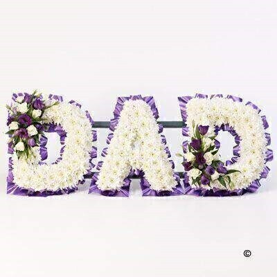 A mass of white double spray chrysanthemums is finished with delicate sprays of roses and lisianthus in white and purple to create this Dad tribute.