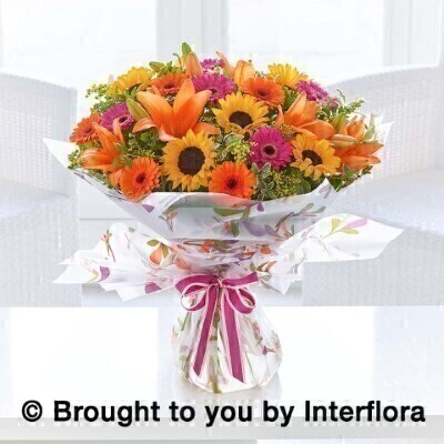 Bouquet of Flowers<br><br>Hand arranged by our florists into a hand tied gift wrapped into a water bubble and box to make a presentation bouquet To give you the best occasionally we may make substitutes Our flowers backed by our 7 days freshness guarantee Approximate dimensions 50x48cm  This product is available for delivery throughout the UK - IN SEPTEMBER ONLY  <br><br>THIS PRODUCT COMES HAND ARRANGED AND GIFT WRAPPED IN A WATER BUBBLE PRESENTED IN A BOX. This bright seasonal bouquet is a delightful choice for someone special. An autumnal colour palette of orange yellow cerise and green. <br><br>Featuring sunflowers gerberas lilies and solidaster hand arranged with mixed foliage.  Hand tied and wrapped in a water bubble and delivered in a presentation box.<br><br> Liverpool Flower Delivery<br><br> We offer advanced booking flower delivery same day flower delivery 3 hour Flower delivery guaranteed AM PM or Evening Flower Delivery and we are now offering Sunday Flower Delivery.<br><br> The best florist in Liverpool<br><br> Come to Booker Flowers and Gifts Liverpool for your Beautiful Flowers and Plants if you really want to spoil we also have a great range of Wines Champagne Beers Balloons Vases and Chocolates that can be delivered with your flowers. To see the full range see our extras section. You can trust Booker Flowers and Gifts can deliver the very best for you