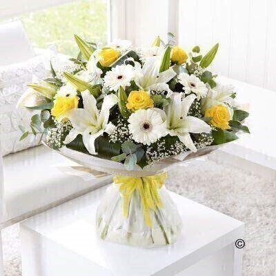 Extra Large version of the Congratulations Hand-Tied. andnbsp;Send your congratulations in style with this bright and sunny bouquet. Weandrsquo;ve carefully hand-tied a selection of white lilies and germini and added radiant yellow roses for a perfect contrast. Tiny white gypsophila flowers give this gift an extra touch of magic. Featuring white germini - yellow large-headed roses - white Oriental lilies and white gypsophila - hand-tied with folded aspidistra leaves - eucalyptus and salal - wrapped and trimmed with yellow andlsquo;Congratulationsandrsquo; ribbon.