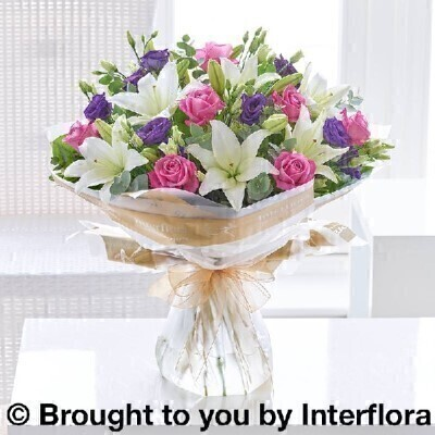 Bouquet of Flowers<br><br>Hand arranged by our florists into a hand tied gift wrapped into a water bubble and box to make a presentation bouquet To give you the best occasionally we may make substitutes Our flowers backed by our 7 days freshness guarantee Approximate dimensions 50x46cm  This product is available for delivery throughout the UK <br><br>THIS PRODUCT COMES HAND ARRANGED AND GIFT WRAPPED IN A WATER BUBBLE PRESENTED IN A BOX. This dreamy bouquet is a delightful choice for someone special. A sophisticated colour palette of pink purple and white flowers together with lush green foliage. <br><br>Featuring cream large headed roses white lisianthus white freesia white spray chrysanthemums green thlaspi hand arranged with eucalyptus and pittosporum.  Hand tied and wrapped in a water bubble and delivered in a presentation box.<br><br> Liverpool Flower Delivery<br><br> We offer advanced booking flower delivery same day flower delivery 3 hour Flower delivery guaranteed AM PM or Evening Flower Delivery and we are now offering Sunday Flower Delivery.<br><br> The best florist in Liverpool<br><br> Come to Booker Flowers and Gifts Liverpool for your Beautiful Flowers and Plants if you really want to spoil we also have a great range of Wines Champagne Beers Balloons Vases and Chocolates that can be delivered with your flowers. To see the full range see our extras section. You can trust Booker Flowers and Gifts can deliver the very best for you