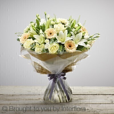 Extra Large version of our New Baby Hand-tied. andnbsp;Bursting with life - this hand-tied bouquet is an exquisite display of pristine white and sunshine yellow flowers. Itandrsquo;s a lovely way to welcome a new life into the world and is sure to be received with pleasure and displayed with pride. Featuring white germini - yellow large headed roses and white Oriental lilies - hand-tied with gypsophila - aspidistra leaves - eucalyptus and salal - gift-wrapped and trimmed with a yellow andlsquo;Congratulationsandrsquo; ribbon.