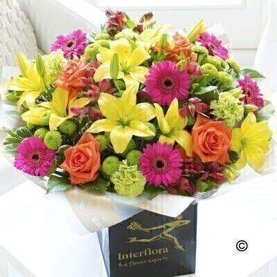 Extra Large Version of our New Baby Vibrant Hand-Tied. andnbsp;Now that baby is safely here - why not add to the joyful - celebratory mood with this showstopper bouquet of brightly coloured fresh flowers? Weandrsquo;ve chosen a vibrant colour palette of cerise - lime green - orange and yellow - the result is sure to surprise and delight them. Featuring cerise alstroemeria - green carnations - cerise germini - yellow Asiatic lilies - orange large headed roses and green spray chrysanthemums with pittosporum and salal - gift-wrapped and presented in an Interflora gift bag.