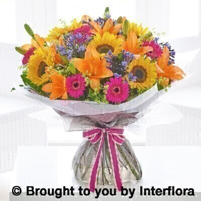 Extra large agapanthus and sunflower hand tied: Booker Flowers and Gifts