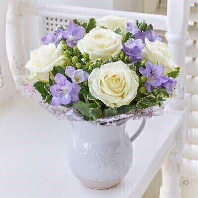 Fragrant Rose and Freesia Jug - White and Blue: Booker Flowers and Gifts