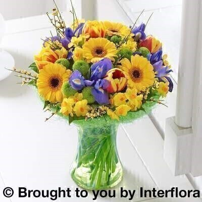 Large Spring flowers in colourful vase