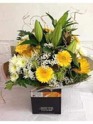 Flowers Delivered Liverpool<br><br>This gold yellow and white hand tied is the perfect colours for Golden Wedding Flowers 50th Wedding Anniversary Bouquet. Seasonal yellow and white flowers are hand arranged by our skilled florists at Booker Flowers and Gifts. This beautiful hand tied presentation bouquet contains Lily Sunflowers Gerbera Gypsy Grass Chrysanthemums Alstromerias Gold Eryngium Sea Holly and Gold Ting which are all artfully arranged with luscious greenery <br><br>We offer advanced booking flower delivery same day flower delivery 3 hour Flower delivery guaranteed AM PM or Evening Flower Delivery and we are now offering Sunday Flower Delivery.<br><br>Hand arranged by our florists gift wrapped in water presented in a box to make a presentation bouquet To give the best occasionally we may make substitutes Our flowers backed by our 7 days freshness guarantee Approximate dimensions 40x25cm  This product is only available for delivery Liverpool areas that we would cover ourselves. So postcodes beginning with L1 L2 L3 L4 L5 L6 L7 L8 L11 L12 L13 L14 L15 L16 L17 L18 L19 L24 L25 L26 L27 L36 L70 <br><br>The best florist in Liverpool<br><br>Come to Booker Flowers and Gifts Liverpool for your Beautiful Flowers and Plants if you really want to spoil we also have a great range of Wines Champagne Balloons Vases and Chocolates that can be delivered with your flowers. To see the full range see our extras section. You can trust Booker Flowers and Gifts can deliver the very best for you