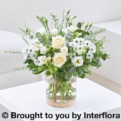 Flowers in a Vase<br><br>Hand arranged by our florists into a stylish glass vase To give you the best occasionally we may make substitutes Our flowers backed by our 7 days freshness guarantee Approximate dimensions 30x30cm  This product is available for delivery throughout the UK <br><br>This classic mix of white flowers and lush green foliage looks gorgeous in this simple yet stylish glass vase and will not look out of place in anyones home. <br><br>Featuring cream large headed roses white lisianthus white freesia white spray chrysanthemums green thlaspi hand arranged with eucalyptus and pittosporum.  A perfect gift for any occasion.<br><br> Liverpool Flower Delivery<br><br> We offer advanced booking flower delivery same day flower delivery 3 hour Flower delivery guaranteed AM PM or Evening Flower Delivery and we are now offering Sunday Flower Delivery.<br><br> The best florist in Liverpool<br><br> Come to Booker Flowers and Gifts Liverpool for your Beautiful Flowers and Plants if you really want to spoil we also have a great range of Wines Champagne Beers Balloons Vases and Chocolates that can be delivered with your flowers. To see the full range see our extras section. You can trust Booker Flowers and Gifts can deliver the very best for you