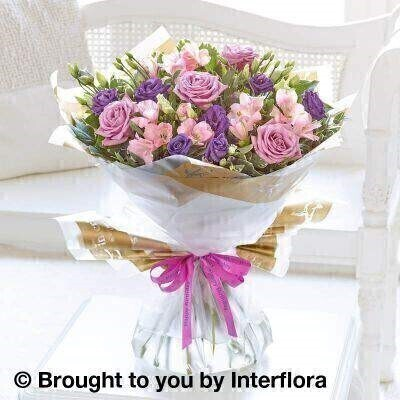 Pink and Purple Flowers – Bouquet in a Box <br><br> Liverpool Flower Delivery<br><br> We offer advanced booking flower delivery same day flower delivery 3 hour Flower delivery guaranteed AM PM or Evening Flower Delivery and we are now offering Sunday Flower Delivery. .<br><br> <ul><li>Hand arranged by our florists</li><li> To give the best occasionally we may make substitutes</li><li> Our flowers backed by our 7 days freshness guarantee</li><li> Approximate dimensions 50x40cm</li><li> This product is available for delivery throughout the UK</li></ul><br><br>  THIS PRODUCT COMES HAND ARRANANGED AND GIFT WRAPPED IN A WATER BUBBLE PRESENTED IN A BOX This elegant bouquet is a delightful choice for someone special. A sophisticated colour palette of pink  lilac and purple brings out the natural beauty of each flower – and the real stars are these Cool Water roses in their distinctive shade of dusky lilac.<br><br>  Featuring pink alstroemeria  blue lisianthus and lilac Cool Water large headed roses with eucalyptus  pittosporum and salal  wrapped and trimmed with a Happy Birthday ribbon.<br><br> The best florist in Liverpool<b><b>Come to Booker Flowers and Gifts Liverpool for your Beautiful Flowers and Plants if you really want to spoil we also have a great range of Wines Champagne Balloons Vases and Chocolates that can be delivered with your flowers. To see the full range see our extras section. You can trust Booker Flowers and Gifts can deliver the very best for you