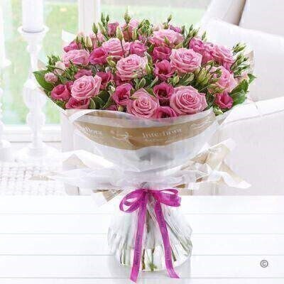 THIS PRODUCT COMES HAND ARRANGED AND GIFT WRAPPED IN A WATER BUBBLE PRESENTED IN A BOX Indulge her passion for pink with this ultra-feminine bouquet. We've chosen classic roses for their enduring beauty and delicate lisianthus for extra detail. The soft pink shades of both varieties look wonderful together and are sure to prompt a smile of pure pleasure. Featuring pink lisianthus and pink large headed roses with salal and pittosporum wrapped and trimmed with a 'Happy Birthday' ribbon.