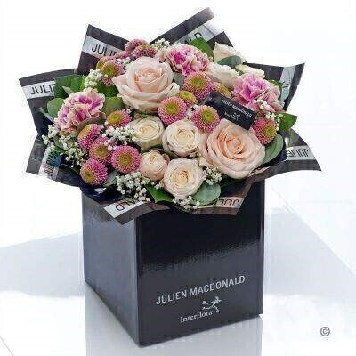 This hand-tied bouquet in glorious warm pink and peach tones has a timeless quality that is particularly captivating. Inspired by the enduring appeal of these classic flower varieties we've selected the finest quality fresh blooms to create this very feminine vintage style gift. <br><br>Featuring 3 pink spray chrysanthemums 3 pink carnations 2 light pink large headed roses and 2 light pink spray roses with gypsophilia eucalyptus and salal presented in Julien Macdonald foil wrap and a dual-branded gift box with designer gift tag and ribbon. This hand-tied is tightly constructed to create a neat compact posy of flowers. <br><br>This product contains 12 stems. <br><br>Approximate Product Dimensions: Height: 38cm Width: 36cm
