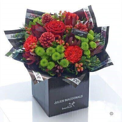 <h1>Flowers Delivered Liverpool</h1><br><br> This festive hand-tied is the epitome of chic. Sumptuous reds  rich burgundy and fresh green tones really draw the eye to this stylish Christmas gift. The luxurious rose at the heart of this display is the real star of the show. A truly sophisticated gift for someone special.<br><br>  Featuring a red large headed rose  3 red carnations  3 green spray chrysanthemums and 3 red hypericum with burgundy spray leucadendron  scotts pine  salal and glittered pine cones  presented in Julien Macdonald foil wrap and a dual-branded gift box with designer gift tag and ribbon. This hand-tied is tightly constructed to create a neat  compact posy of flowers<br><br> We offer advanced booking flower delivery same day flower delivery 3 hour Flower delivery guaranteed AM PM or Evening Flower Delivery and we are now offering Sunday Flower Delivery.<br><br><ul><li>This product is hand arranged and comes in a water bubble<li><li> To give the best occasionally we may make substitutes </li><li>Our flowers backed by our 7 days freshness guarantee</li><li> Approximate dimensions 40x42cm </li><li>This product is available for delivery throughout the UK </li></ul><br><br>The best florist in Liverpool<br><br>  Come to Booker Flowers and Gifts Liverpool for your Beautiful Flowers and Plants if you really want to spoil we also have a great range of Wines Champagne Balloons Vases and Chocolates that can be delivered with your flowers. To see the full range see our extras section. You can trust Booker Flowers and Gifts can deliver the very best for you