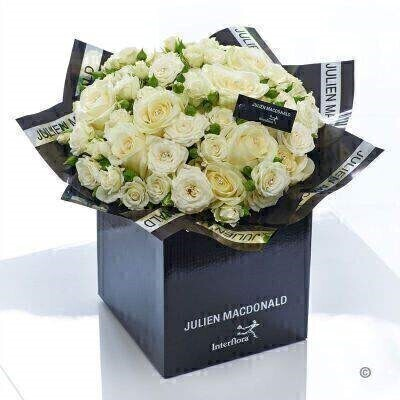 When only perfection will do this breathtakingly elegant bouquet of magnificent pure white Avalanche roses is just right. Each immaculate bloom is beautifully contoured and pristine. We've simply added a few sparkling diamante pins to enhance the natural glamour to this stunning gift.<br><br>Featuring 10 white large headed roses and 4 white spray roses with salal decorated with diamante pins and presented in Julien Macdonald foil wrap and a dual-branded gift box with designer gift tag and ribbon. This hand-tied is tightly constructed to create a neat compact posy of flowers.<br><br>This product contains 14 stems.<br><br>Approximate Product Dimensions: Height: 38cm Width: 34cm