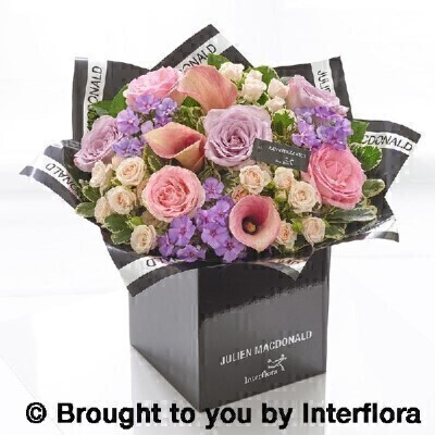 Julien Macdonald summer rose and calla lily hand tied: Booker Flowers and Gifts