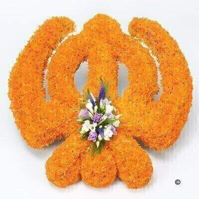 A mass of orange double spray chrysanthemums forms the Khanda tribute which is finished with a spray of white freesias - lilac lisianthus and blue veronica.