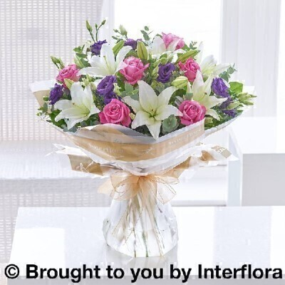 Bouquet of Flowers<br><br>Hand arranged by our florists into a hand tied gift wrapped into a water bubble and box to make a presentation bouquet To give you the best occasionally we may make substitutes Our flowers backed by our 7 days freshness guarantee Approximate dimensions 50x44cm  This product is available for delivery throughout the UK <br><br>THIS PRODUCT COMES HAND ARRANGED AND GIFT WRAPPED IN A WATER BUBBLE PRESENTED IN A BOX. This dreamy bouquet is a delightful choice for someone special. A sophisticated colour palette of pink purple and white flowers together with lush green foliage. <br><br>Featuring cream large headed roses white lisianthus white freesia white spray chrysanthemums green thlaspi hand arranged with eucalyptus and pittosporum.  Hand tied and wrapped in a water bubble and delivered in a presentation box.<br><br> Liverpool Flower Delivery<br><br> We offer advanced booking flower delivery same day flower delivery 3 hour Flower delivery guaranteed AM PM or Evening Flower Delivery and we are now offering Sunday Flower Delivery.<br><br> The best florist in Liverpool<br><br> Come to Booker Flowers and Gifts Liverpool for your Beautiful Flowers and Plants if you really want to spoil we also have a great range of Wines Champagne Beers Balloons Vases and Chocolates that can be delivered with your flowers. To see the full range see our extras section. You can trust Booker Flowers and Gifts can deliver the very best for you