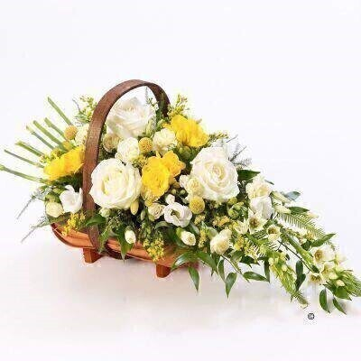 A Large Version of our Yellow and White Mixed Basket Arrangement. andnbsp;A traditional trug basket filled with roses - scented freesia - craspedia - spray carnations and ornithogalum in white and yellow arranged in a sheaf-like design.