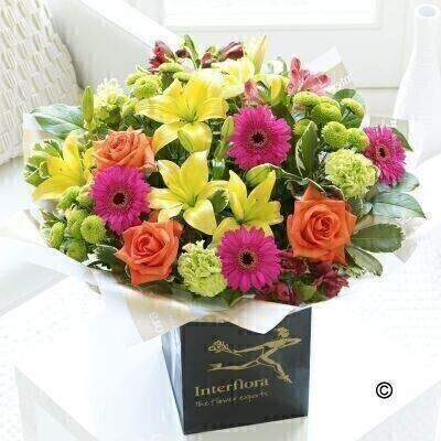 Large Version of our New Baby Vibrant Hand-Tied. andnbsp;Now that baby is safely here - why not add to the joyful - celebratory mood with this showstopper bouquet of brightly coloured fresh flowers? Weandrsquo;ve chosen a vibrant colour palette of cerise - lime green - orange and yellow - the result is sure to surprise and delight them. Featuring cerise alstroemeria - green carnations - cerise germini - yellow Asiatic lilies - orange large headed roses and green spray chrysanthemums with pittosporum and salal - gift-wrapped and presented in an Interflora gift bag.