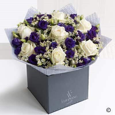 Large version of the Vera Wang Dreamy Romance. andnbsp;This stunning Vera Wang bouquet is a wonderfully romantic mix of exquisite creamy coloured roses - rich purple double lisianthus and silvery white limonium - lovingly hand-tied and finished with glossy green leaves. The effect is chic and incredibly beautiful. Featuring Ice Bear cream roses - purple double lisianthus and fresh limonium - expertly hand-tied and finished with luxurious Vera Wang gift wrapping.