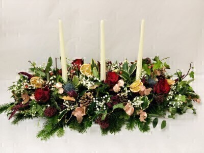 Long Christmas Table Centrepiece with Candles: Booker Flowers and Gifts