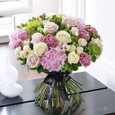 This magnificent hand-tied bouquet of the very finest premium quality flowers is a luxurious choice that retains a sense of stylish informality too. If they love flowers they're guaranteed to feel very special receiving this thoughtful gift in pretty tones of pink cream and fresh lime.<br><br>eaturing bi-colour Genache carnations white Avalanche large headed roses Verena pink hydrangea pink Sweet Avalanche large headed roses Selva green hypericum green Anastasia chrysanthemums cream Super Bubbles spray roses and white Ambassador freesia with pittosporum and salal expertly hand-tied and finished with luxury gold gift wrapping for maximum impact when your gift is delivered.<br><br>Approximate Product Dimensions: Height: 40cm Width: 45cm<br><br>This product Contains 31 Stems