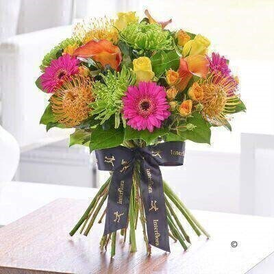 THIS PRODUCT COMES HAND ARRANGED AND GIFT WRAPPED IN A WATER BUBBLE PRESENTED IN A BOX.<br><br>Vivid contrasts delicate shapes and detail ensure this designer bouquet stands out from the crowd. The eclectic mix of hot pink lime green and vibrant orange and yellow shades works wonderfully giving this bouquet warmth and personality as well as stunning beauty.<br><br>Featuring orange Captain Odeon calla lilies Anastasia dark green chrysanthemum blooms cerise Whisper germini orange abeba spray roses yellow Penny Lane large headed roses and orange Soleil leucospernum with salal expertly hand-tied and presented in luxurious packaging for maximum impact when your gift is delivered.<br><br>This product contains 18 stems.<br><br>Approximate Product Dimensions:<br><br>Height: 39cm Width: 36cm