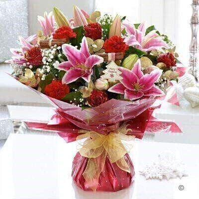 <h1>Flowers Delivered Liverpool</h1><br><br> We have designed this special occasion bouquet to reflect the celebratory mood of the season in all its magical glory. There is festive red tones star-shaped lilies glitter and gold and tiny white gypsophilia – just like a flurry of fresh snow. What a delightful Christmas surprise!<br><br>   Featuring red carnations pink Oriental lily and red roses with gold glitter hand-tied with gypsophila aspidistra leaves gold eucalyptus and salal wrapped and trimmed with gold voile ribbon a cinnamon bundle and a Christmas gift tag<br><br> We offer advanced booking flower delivery same day flower delivery 3 hour Flower delivery guaranteed AM PM or Evening Flower Delivery and we are now offering Sunday Flower Delivery.<br><br><ul><li>This product is hand arranged and comes in a water bubble<li><li> To give the best occasionally we may make substitutes </li><li>Our flowers backed by our 7 days freshness guarantee</li><li> Approximate dimensions 50x45cm </li><li>This product is available for delivery throughout the UK </li></ul><br><br>The best florist in Liverpool<br><br>  Come to Booker Flowers and Gifts Liverpool for your Beautiful Flowers and Plants if you really want to spoil we also have a great range of Wines Champagne Balloons Vases and Chocolates that can be delivered with your flowers. To see the full range see our extras section. You can trust Booker Flowers and Gifts can deliver the very best for you