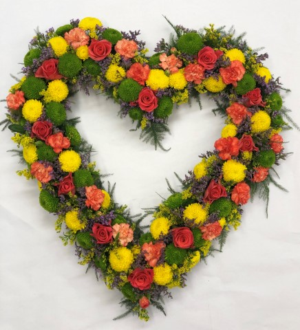 The perfect tribute for a loved one - this open heart shaped display includes fresh flowers in contrasting colours. We've included cerise roses - golden yellow spray chrysanthemums - orange spray carnations - cool purple statice and lime green spray chrysanthemums.