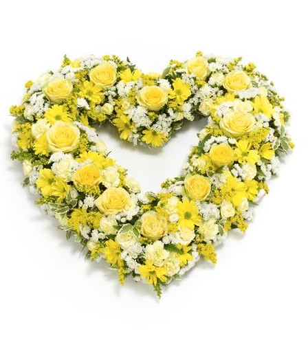 This open heart tribute is a sea of lemon yellows and gold contrasted with cream and white shades. The arrangement includes fresh yellow roses - spray chrysanthemums - spray carnations and statice with solidago - pittosporum and leather leaf.