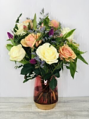 Mixed Spring Flowers in a VaseHand arranged by our florists into a rose glass vaseTo give you the best occasionally we may make substitutesOur flowers backed by our 7 days freshness guaranteeApproximate dimensions 35cmx34cmThis product is available for UK deliveryThese beautiful flowers hand arranged into a glass vase is a delightful choice to celebrate Spring. Ideal gift for a Birthday or gift just because you can. This is the large size with more stems than the standard sizeFeaturing 4 peach large-headed roses 4 cream large-headed roses 3 cerise alstroemeria 4 purple tulips and 2 pink limonium artfully arranged into this beautiful keepsake rose and gold coloured glass vase. Plus all our bouquets and plants have a small wooden ladybird hidden in somewhere so dont forget to spot the ladybird on our social media pages!Liverpool Flower DeliveryWe offer advanced booking flower delivery same day flower delivery 3 hour Flower delivery guaranteed AM PM or Evening Flower Delivery and we are now offering Sunday Flower Delivery.The best florist in LiverpoolCome to Booker Flowers and Gifts Liverpool for your Beautiful Flowers and Plants if you really want to spoil we also have a great range of Local Gin Wines Champagne Balloons Vases and Chocolates that can be delivered with your flowers. To see the full range see our extras section. You can trust Booker Flowers and Gifts can deliver the very best for you.