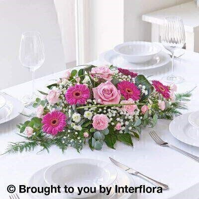 Pink Flowers  Table Centrepiece <br><br>Liverpool Flower Delivery<br><br>We offer advanced booking flower delivery same day flower delivery 3 hour Flower delivery guaranteed AM PM or Evening Flower Delivery and we are now offering Sunday Flower Delivery. .<br><br>Hand arranged by our florists To give the best occasionally we may make substitutes Our flowers backed by our 7 days freshness guarantee Approximate dimensions 28x17cm This product is available for delivery throughout the UK<br><br>THIS ARRANGMENT IS IN FLORAL FOAM AND COMES PRE ARRANGED IN CONTAINER Hot pink germini and pink roses are combined with delicate fronds of gypsophila to create a beautiful oval shaped centrepiece suitable for any occasion enhancing your dinner table.<br><br>Featuring 5 cerise germini 2 large-headed pink roses 4 light pink spray carnations 1 white gypsophila 1 white spray chrysanthemum arranged with asparagus fern aspidistra and aralia steel grass and eucalyptus.<br><br>The best florist in Liverpool<b><b>Come to Booker Flowers and Gifts Liverpool for your Beautiful Flowers and Plants if you really want to spoil we also have a great range of Wines Champagne Balloons Vases and Chocolates that can be delivered with your flowers. To see the full range see our extras section. You can trust Booker Flowers and Gifts can deliver the very best for you