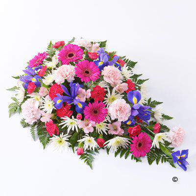 The bold shape of blue irises blend perfectly with the pink and white colours of carnations and spray carnations - spray chrysanthemums and alstroemeria. This is softened by the shape of the foliage to create this large teardrop-shaped spray.