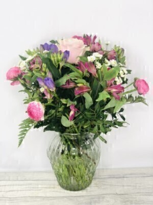 Pink and Purple Summer Flowers - Hand DeliveredHand arranged by our florists into a beautiful glass vaseTo give you the best occasionally we may make substitutesOur flowers backed by our 7 days freshness guaranteeApproximate dimensions 40cmx30cmThis product is ONLY available for delivery Liverpool areas that we would cover ourselves. So postcodes beginning with L1 L2 L3 L4 L5 L6 L7 L8 L11 L12 L13 L14 L15 L16 L17 L18 L19 L24 L25 L26 L27 L36 L70These beautiful Summer flowers hand arranged by our professional florists into a clear glass vase are a delightful choice from our new Summer collection. This bouquet of pink and purple seasonal flowers would make the perfect gift to let someone know you are thinking of them. Featuring 1 pink large-headed rose 3 purple freesia pink ranunculus cerise alstroemeria and 3 white santini spray chrysantheums all hand arranged with mixed foliage into a clear glass bevelled vase. Plus all our bouquets and plants have a small wooden ladybird hidden in somewhere so dont forget to spot the ladybird on our social media pages!Liverpool Flower DeliveryWe are open 7 days a week and offer advanced booking flower delivery same day flower delivery 3 hour Flower delivery guaranteed AM PM or Evening Flower Delivery and offer Sunday Flower Delivery.The best florist in LiverpoolCome to Booker Flowers and Gifts Liverpool for your Beautiful Flowers and Plants if you really want to spoil we also have a great range of Local Gin Wines Champagne Balloons Vases and Chocolates that can be delivered with your flowers. To see the full range see our extras section. You can trust Booker Flowers and Gifts can deliver the very best for you.