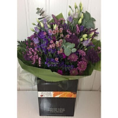 Purple Flowers Bouquet in a box <br><br>Hand arranged by our florists in box to form a presentation bouquet  To give you the best occasionally we may make substitutes Our flowers backed by our 7 days freshness guarantee Approximate dimensions 60x40cm  This product is only available for delivery Liverpool areas that we would cover ourselves. So postcodes beginning with L1 L2 L3 L4 L5 L6 L7 L8 L11 L12 L13 L14 L15 L16 L17 L18 L19 L24 L25 L26 L27 L36 L70 <br><br>This bouquet of flowers is a real stunner lots all purple flowers mixed with luscious greenery making it a perfect gift for a flowers lover who love the colour purple. This bouquet has flowers with lots of different shapes and textures giving it a meadow garden feel.<br><br>This example contains purple Carnations Sweet William Wax flower Statice Lissianthus Heather and Chrystanthemums mixed with textured greenery <br><br> Liverpool Flower Delivery<br><br> We offer advanced booking flower delivery same day flower delivery 3 hour Flower delivery guaranteed AM PM or Evening Flower Delivery and we are now offering Sunday Flower Delivery.<br><br> The best florist in Liverpool<br><br> Come to Booker Flowers and Gifts Liverpool for your Beautiful Flowers and Plants if you really want to spoil we also have a great range of Wines Champagne Balloons Vases and Chocolates that can be delivered with your flowers. To see the full range see our extras section. You can trust Booker Flowers and Gifts can deliver the very best for you